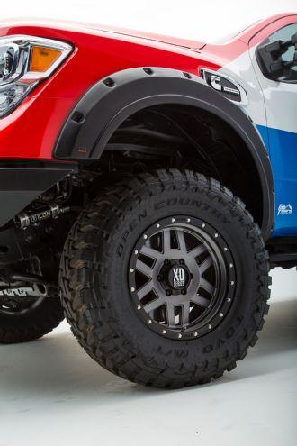 009-2016-nissan-titan-xd-cummins-diesel-sema-build-kmc-xd128-machete-wheels-and-toyo-open-country-mt-tires-and-egr-fender-flare